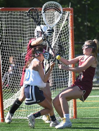 BRYAN EATON/Staff Photo. Samantha Cavanaugh aids goalie Erin Osinski to stop a shot by Swampscott's Scarlett Ciciotti.
