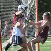 BRYAN EATON/Staff Photo. Samantha Cavanaugh aids goalie Erin Osinski to stop a shot by Swampscott's Scarlett Ciciotti.
