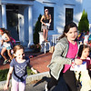 "BRYAN EATON/Staff Photo. Sharon Kennedy smiles as youngsters from her neighborhood on Munroe Street in Newburyport head out on a scavenger hunt. She worked with the Let Grow Committee with Youth Services and is part of the group of parents leading the charge to create more free play and neighborhood play for kids in Newburyport. She and her daughters organized the neighborhood scavenger hunt and invited several blocks worth of kids in the north end. It was a suggestion from the book ""Playborhood"" to create an event that pulls people together."