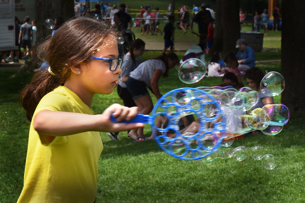 BRYAN EATON/Staff Photo. Sophie Himmel, 10, of Amesbury has fun at the bubble station at Amesbury Days' Kids Day in the Park.