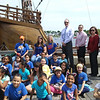 JIM SULLIVAN/Staff Photo. Tilton School teachers and their students pose in front of the ship.