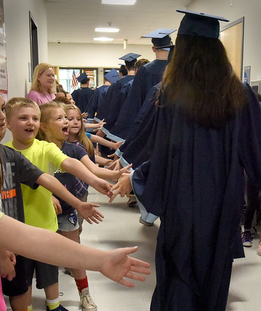 BRYAN EATON/Staff Photo. Soon-to-be Triton gradutes from Salisbury walked the halls of the elementary school on Thursday greeting youngsters who line the hallways. The seniors later spoke to the older classes about a range of subjects.