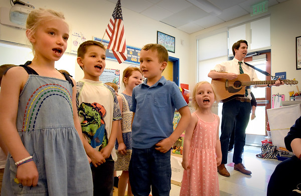 """BRYAN EATON/Staff Photo. Kindergarters in Linda Gershuny's class sing """"I'm Gonna Let It Shine"""" under the director of Bresnahan School music teacher Gardner Rulon-Miller at right. Kindergartners were having an end of year celebration singing songs they learned over the year and showing folders of their work to their parents."""