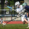 BRYAN EATON/Staff Photo. Pat Dillon scoops up the loose ball with a Lowell Catholic in pursuit.