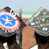 JIM VAIKNORAS/Staff photo Pentucket graduates Kalyn and Mackenzie Markuns show their allegiance to the Marvel and Star wars movie franchises  at Commencement Saturday morning.