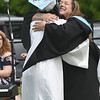 JIM VAIKNORAS/Staff photo Pentucket graduate Jada Finnamore hugs class advisor Janna Millard at Commencement Saturday morning.