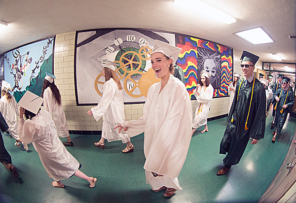JIM VAIKNORAS/Staff photo Pentucket seniors make their way through the school towards Commencement Saturday morning.
