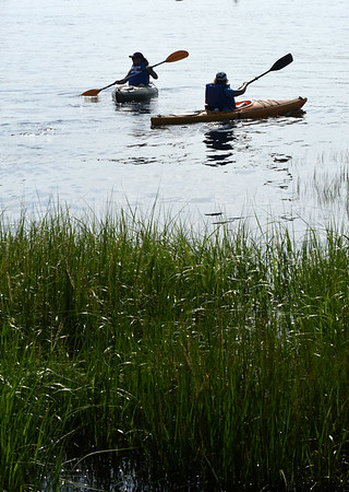 BRYAN EATON/File photo. There are many places to explore in the Merrimack River for kayakers including Carr, Ram and Eagle Islands near Cashman Park where these two launched.