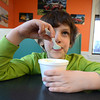 newburyport: Paul Sybert, 6, enjoys a cup of cotton candy ice cream at Haley's in Newburyport Friday. Paul is a first grader at the Bresnahan School. His favorite color is blue, which is why he likes cotton candy ice cream