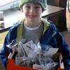 JIM VAIKNORAS/Staff photo Sebastian freeman 8, sells cookies to raise money at the Riverside Rockets Pan Mass Challenge bike swap at the Tannery in Newburyport. Since 2012 the team has raised over $250,000.