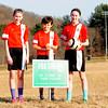 JIM VAIKNORAS/Staff photo Mckenna Hallinan,12, Drew Davis, 12, and Avery Hallinan pose at Woodsom Farm in Amesbury.