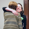 JIM VAIKNORAS/Staff photo Senator Kathleen O'Connor Ives gets a hug from State Auditor Suzanne Bump at the Link House Inc's 15th annual St. Patrick' Day Luncheon at the Masonic Temple in Newburyport Friday.