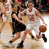 JIM VAIKNORAS/Staff photo  Amesbury's Abigail Sartori makes a move during their game Saturday at Wakefield high school. Amesbury won the game 66-50.