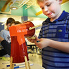 BRYAN EATON/Staff photo. Brody Kelly, 7, and some of his friends decided to create robots using Solo cups, duct tape and clothes pins on Tuesday afternoon. They were in the Newburypot YWCA's School's Out Program which meets in the cafeteria at the Bresnahan School.
