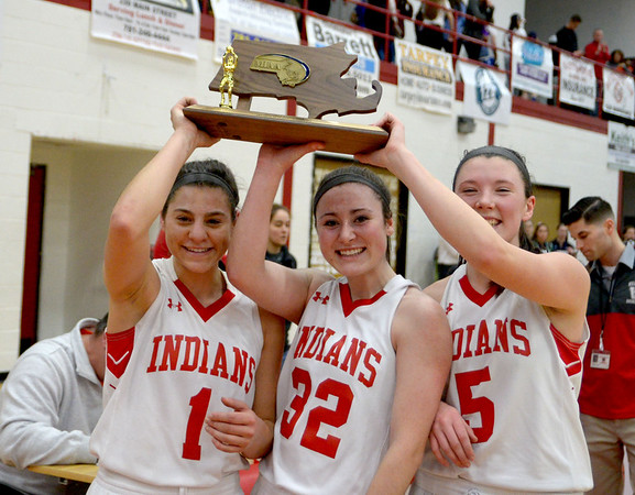 JIM VAIKNORAS/Staff photo Amesbury girl's basketball captains Madison Napoli, Abigail Sartori, and Julia LaMontagne hold up the North Sectional Trophy after the Indian's victory against  Bishop Fenwick Saturday at Wakefield high school. Amesbury won the game 66-50.