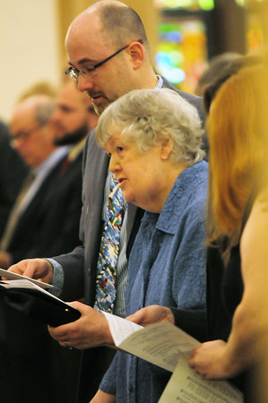 JIM VAIKNORAS/Staff photo Betty Lavender and her son Roy Lavender sing the hymn Amazing Grace at the funeral of their husband and father former Newburyport mayor Al Lavender Wednesday at the Central Congregational Church in Newburyport.