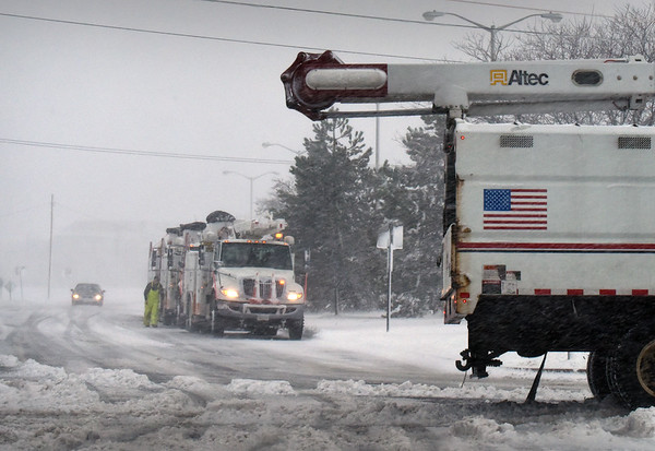 BRYAN EATON/Staff photo. Utility trucks were on standby at Salisbury Beach during the storm. Winds were strongest at the coast.