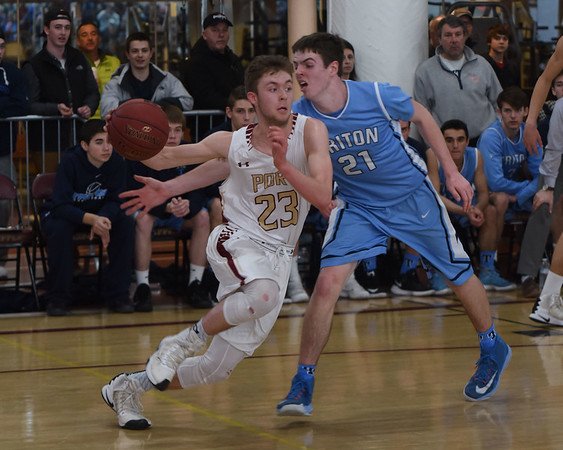 JIM VAIKNORAS/Staff photo  Newburyport's Brendan Powers drives past Triton's Jack McCarthy during the Clippers 59-57 victory over Triton Saturday at Newburyport high school.