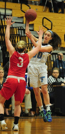 JIM VAIKNORAS/Staff photo Triton's Meredith Kennedy makes a pass against  Melrose's at Triton Tuesday night.