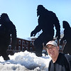 BRYAN EATON/Staff photo. Drew Tire owner Bill Drew with his plywood family of Bigfoots catches the eyes of motorists as they go by his shop in downtown Amesbury.