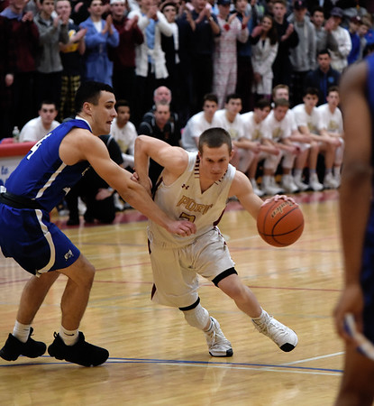 JIM VAIKNORAS/Staff photo Newburyport's Cam MacRae drives past a Bedford player at Tewskbury high school Tuesday night.