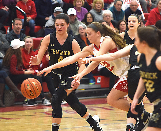 JIM VAIKNORAS/Staff photo  Amesbury's Flannery O'Connor reaches for a loose ball  during the Indian's victory over Bishop Fenwick Saturday at Wakefield high school. Amesbury won the game 66-50.