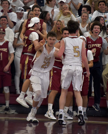 JIM VAIKNORAS/Staff photo Newburyport's #5 Cam McRae  and #23 Brendan Powers celebrate the Clippers  59-57 victory over Triton Saturday at Newburyport high school.