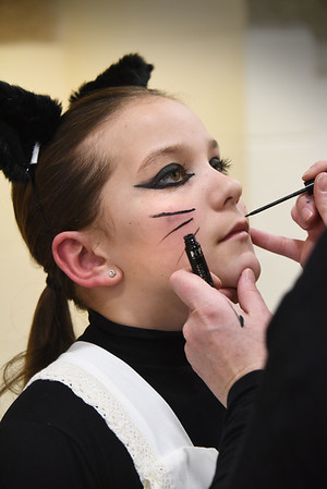 BRYAN EATON/Staff photo. Allison Pugh, who plays Mother Cat, gets her makeup applied