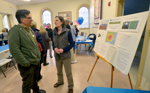 JIM VAIKNORAS/Staff photo Event organizer John Giodano speaks with Natalie Hildt Treat, Executive Director of the C-10 Research and Education Foundation speak at RISE meeting at the Congregational Church in Newburyport Tuesday night.