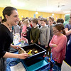 JIM VAIKNORAS/Staff photo Newburyport Public Health Nurse Pam Palumbo talks to 7th graders in the cafeteria at the Nock Middle School in Newburyport about how worms turn food waste into soil. Palumbo and  Recycling and Energy Manager Molly Ettenborough gave a presentation as part of Food Recovery and Recycling Awareness Week at the school. Both the Nock and the Molin have food recovery programs in place, which collects and donate unopened food items and fresh fruit to people who need them through Nourishing the North Shore.