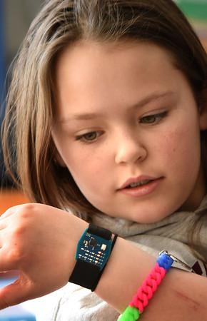 BRYAN EATON/Staff photo. Ani Mellett, 9, and her classmates each got their own watch that Michaels made
