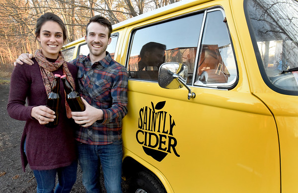 BRYAN EATON/Staff photo. Emily Tassinari and Caleb Noel are introducing their Saintly Cider products this week. They started in Noel's parents' cellar in Rowley and production of the cider is at Ipswich Brewing.