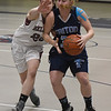 JIM VAIKNORAS/Staff photo  Triton's Erin Savage drives by Belmont's Jane Mahon during their game at Belmont Friday night.