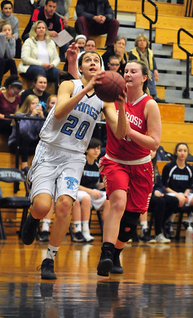 JIM VAIKNORAS/Staff photo Triton's Tess Lafrance drives to the basket  against Melrose at Triton Tuesday night.