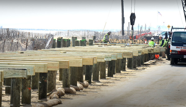BRYAN EATON/Staff photo. The construction of the boardwalk at Salisbury Beach is moving along as the pilings have been shaved and fit with crossbeams. The hope is the structure along the ocean front will be done before the start of tourist season, or shortly thereafter.