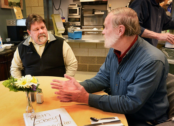 BRYAN EATON/Staff photo. Bruce Augustonovich, left, who is interning at the Amesbury Council on Aging chats with Brad Spear at the senior center.