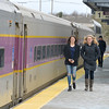 JIM VAIKNORAS/Staff photo Newburyport high school students Rhea Givas and Rebecca Adams walk to boards the commuter rail at Newburyport train station Sunday afternoon. They were on their way to the Museum of Fine Arts in Boston.