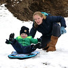JIM VAIKNORAS/Staff photo Tony Tomasz, 2, of Newburyport gets a push from his mom Janey while sledding on March's Hill in Newburyport Sunday afternoon.