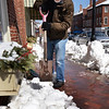 BRYAN EATON/Staff photo. Tuesday's heavy wet snow froze overnight making shoveling Wednesday all that much harder. Greg Nikas, owner of Sweethaven Gallery on Inn Street in Newburyport, does his part to help clear the sidewalk on State Street with a heavy duty square spade.