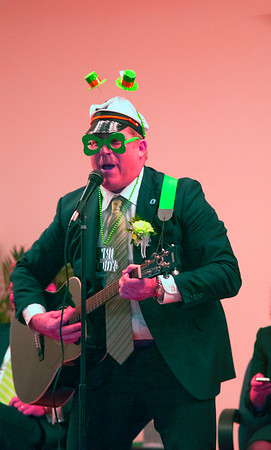 "JIM VAIKNORAS/Staff photo Representative James M. Kelcourse performs his take on the Beatle's song ""Yellow Submarine"" at the Link House Inc's 15th annual St. Patrick' Day Luncheon at the Masonic Temple in Newburyport Friday."