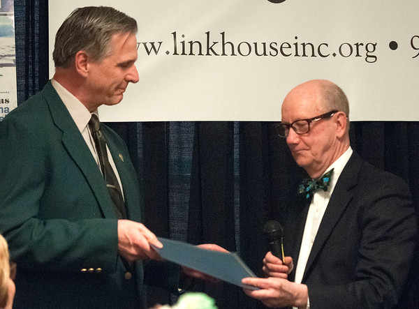 JIM VAIKNORAS/Staff photo Amesbury Police Chief Kevin Ouellet receives Co-Irishman of the Year award from last years recipient Richard Jones  at the Link House Inc's 15th annual St. Patrick' Day Luncheon at the Masonic Temple in Newburyport Friday.
