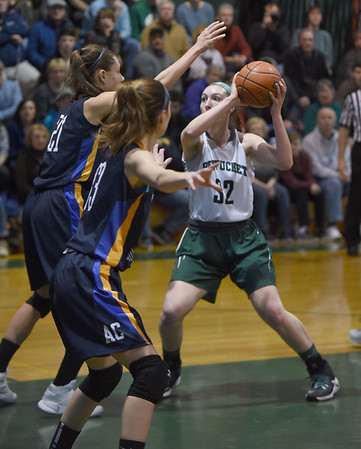 JIM VAIKNORAS/Staff photo Pentucket's Liv Cross makes a move under the basket during their home game against Arlington Catholic Saturday.