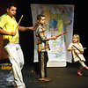 BRYAN EATON/Staff photo. Ryan Rothberg, 11, of the River Valley Charter School, center, and Josie Wizda, 5, of the Newburyport Montessori School got on stage at the Firehouse Center for the Performing Arts to participate with the Afro-Brazilian Ensemble on Wednesday morning. The troupe performed Capoeira: a unique hybrid of martial arts and dance in which partners pair off and spar in graceful, fluid motions and was part of the Firehouse Center's School Show Series.