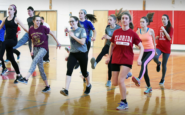 BRYAN EATON/Staff photo. The Amesbury High School girls track team excercise in the school's gymnasium.