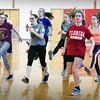 BRYAN EATON/Staff photo. The Amesbury High School girls track team excercise in the school's gymnasium.