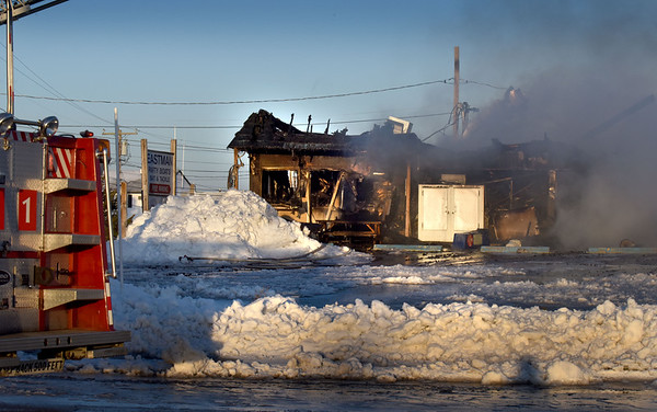BRYAN EATON/Staff photo. An ice chest can be seen in ruins of Catalano's Market at Seabrook Beach which also housed a seasonal barbecue restaurant and reportedly an apartment which were all destroyed by fire early Wednesday morning.