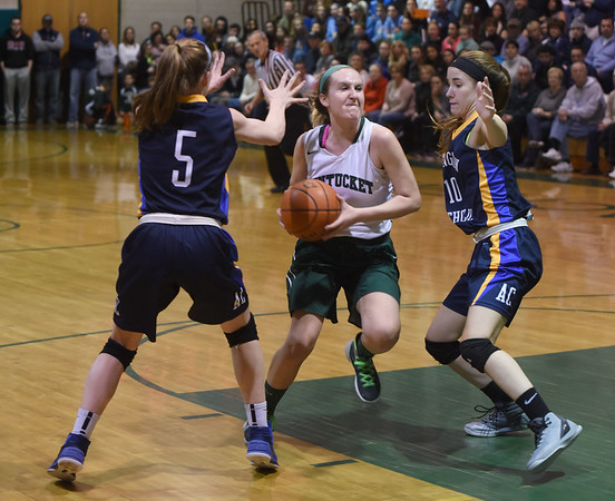 JIM VAIKNORAS/Staff photo Pentucket's Casey Hunt glides to the basket during their home game against Arlington Catholic Saturday.
