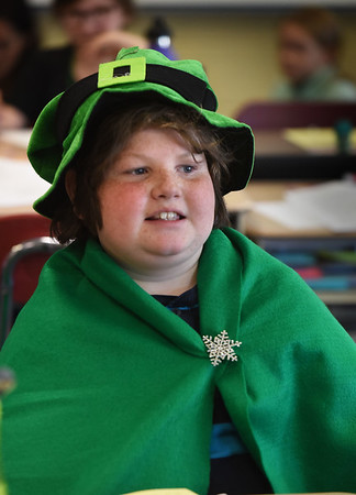 BRYAN EATON/Staff photo. Students at Amesbury Elementary School dressed up in all shades of green with various accessories for St. Patrick's Day. Cillian Harty, 10, dressed up as a Leprechaun with a hat that he's had for several years, but this year added a cape.