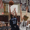 JIM VAIKNORAS/Staff photo  Triton's Alexandra Kennedy shoots over Belmont's Jess Giorgio during their game at Belmont Friday night.