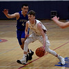 JIM VAIKNORAS/Staff photo Newburyport's Robbie Shay drives past a  Bedford player at Tewskbury high school Tuesday night.